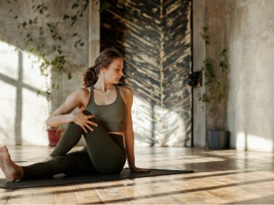 a girl stretching, doing yoga