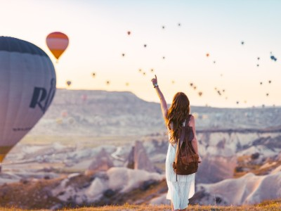 5 Steps To Wake Up The Badass Inside You - girl looking at flying balloons and being happy